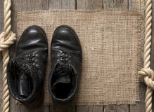 Old Military Shoes On Wooden Boards Stock Images