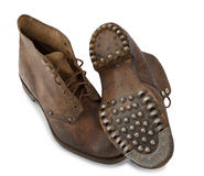 Old military shoes on the white background Royalty Free Stock Photo