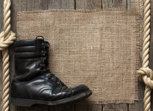 Old military shoes on wooden boards Royalty Free Stock Photo