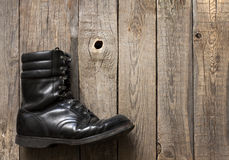 Old military shoes on wooden boards Stock Image