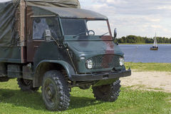 Old military truck near a water body Royalty Free Stock Photo