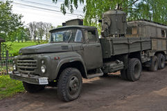 Old military truck parked near an old way. Stock Photos