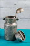 Old milk can and ladle Stock Images