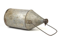 Old milk can on white Royalty Free Stock Photo