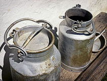 Old milk canisters Stock Image