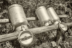 Old milk canisters Royalty Free Stock Image
