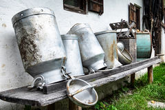 Old milk canisters Stock Images