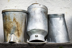 Old milk canisters Royalty Free Stock Images