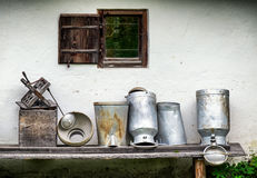 Old milk canisters Stock Photos