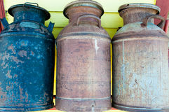 Old Milk Cans. Three rusty but colorful antique milk cans filling the frame. Horizontal. Copy space stock photography