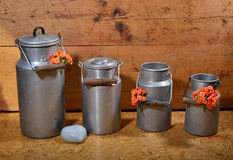 Old milk cans Stock Photos