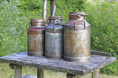 Old milk cans stock images