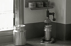 Old milk churn and butter churn Royalty Free Stock Images