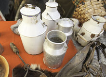 Old milk containers. Detail from  to carry Stock Image