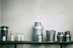 Old milk jugs, cans and bottles Royalty Free Stock Photography