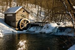 Old Mill. An old water wheel at a 1800's era mill Stock Photo