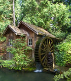 Old Mill. An old mill and water wheel royalty free stock photography