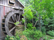 Old Mill. With water wheel in the woods stock photography