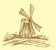 Old mill. Rural background with old windmill Royalty Free Stock Photo