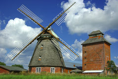 Old mill on a background of the blue sky. stock image