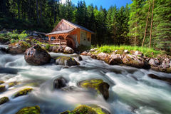 Old mill and beautiful Golling waterfall and near Golling and Sa Stock Image