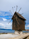 Old mill with birds near the sea.  Stock Photos
