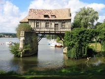 Old mill in the bridge on the Seine at Vernon Stock Photo
