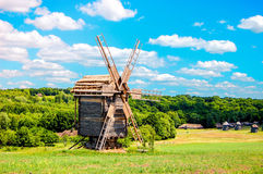 Old mill  on  bright sunny day in the field Royalty Free Stock Photo