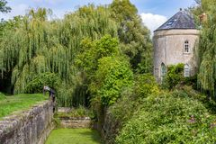 Old Round Mill House Conversion. An old mill building that has been converted into a house by the side of a disused canal royalty free stock photos