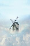 Old mill in clouds Royalty Free Stock Photos