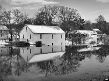 Old mill dam. In the winter shown in black and white Stock Photography