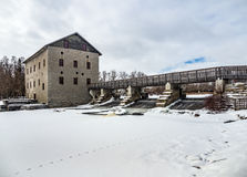 Old Mill at the dam in winter Stock Photos