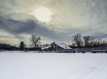Old Mill at the dam in winter. Frozen river waterfall Royalty Free Stock Photography