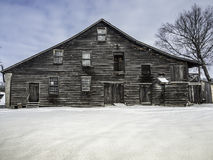 Old Mill at the dam in winter. Frozen river waterfall Royalty Free Stock Photos