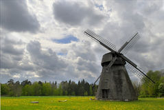 Old mill at dandelion field Royalty Free Stock Image