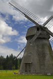 Old mill at dandelion field Stock Photography