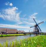 Old mill, farm houses and dyke Royalty Free Stock Photography