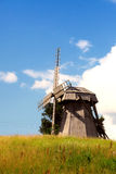 Old mill in the field of a yellow grass Royalty Free Stock Photography