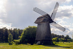 Old mill on a green field Stock Photos