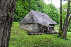 Old mill house in forest royalty free stock images