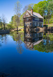 Old mill by the pond Royalty Free Stock Photos