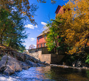 Old mill with river. River flowing past the Old Red Mill in Jericho, Vermont royalty free stock photography
