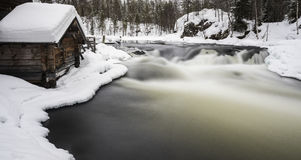 Old mill and the river. Old mill next to the river within Oulanka national park Royalty Free Stock Image