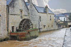 Old mill on river in the town of Bayeux. Royalty Free Stock Images