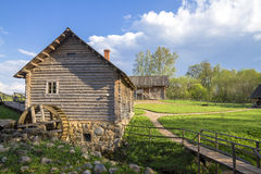 Old mill in russian village. Russian rural landscape with old mill stock images