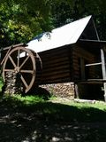 Old mill. Shade sillouette of an old mountain mill Royalty Free Stock Image