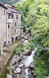Old mill and stream. Times gone by. Picturesque stone buildings. Royalty Free Stock Photo