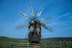 Old mill. Old Ukrainian retro wooden mill summer Pirogovo stock photo