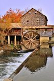Old Mill. Water wheel with fall trees royalty free stock images