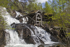 Old mill at waterfall Stock Photo